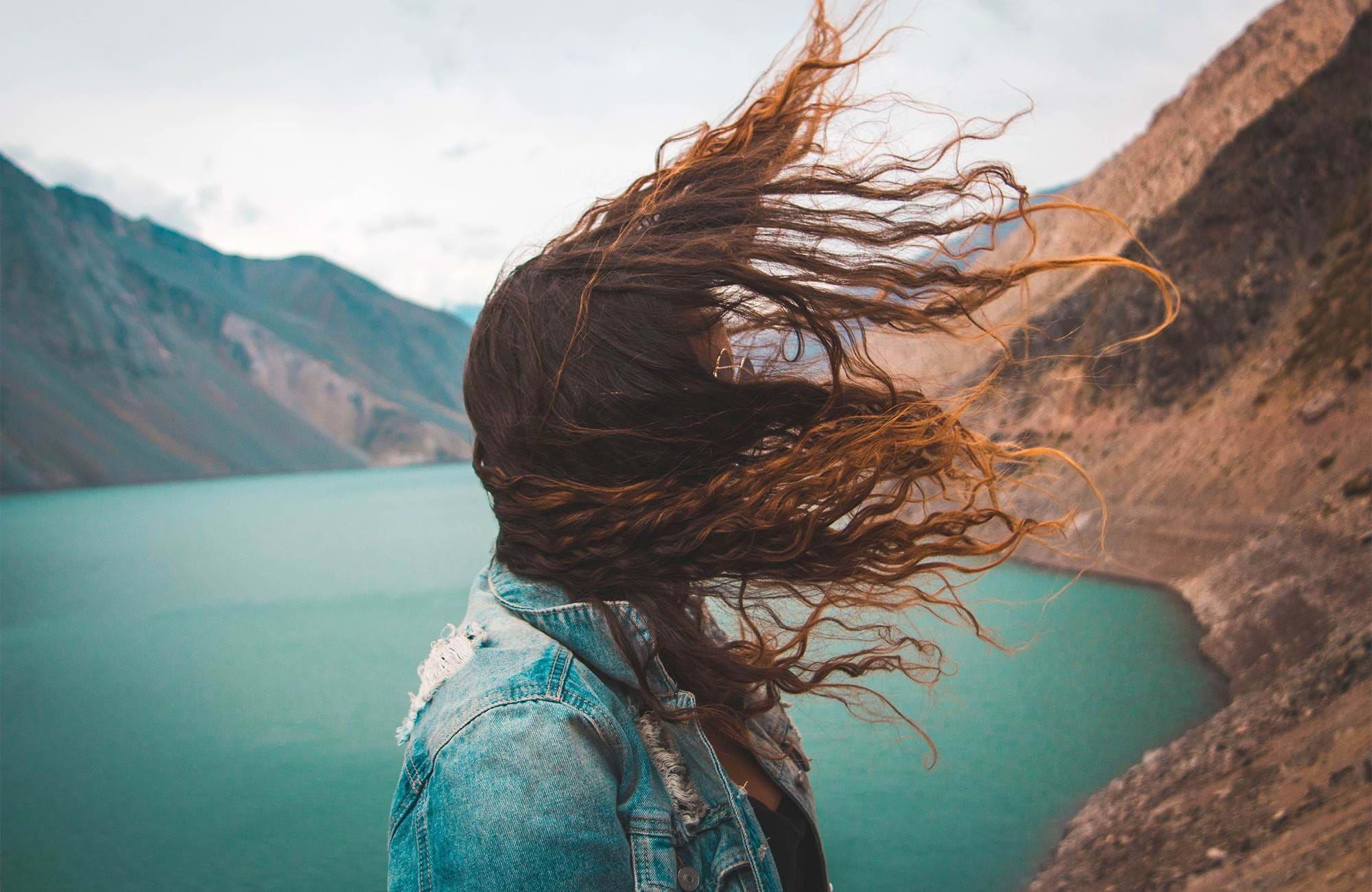chile-girl-wind-hair-embalse-el-yeso-cover