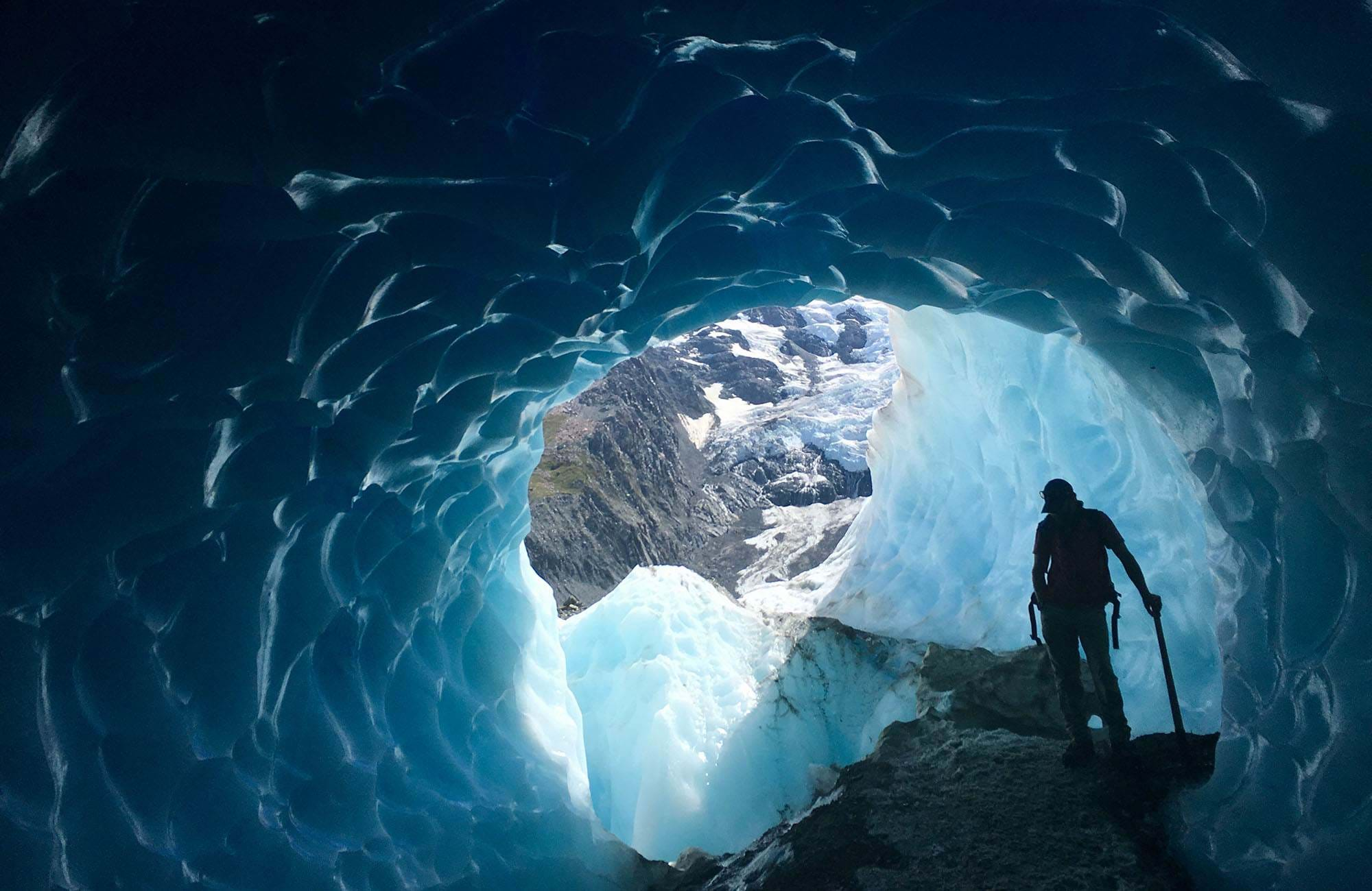 southern-island-new-zealand-tasman-glacier-man-standing-in-glacier-cover